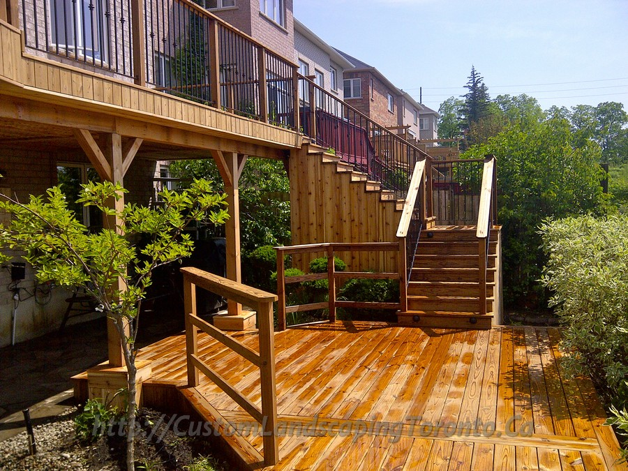Basement walkout interlock with deck and pergola toronto for Walkout basement patio ideas