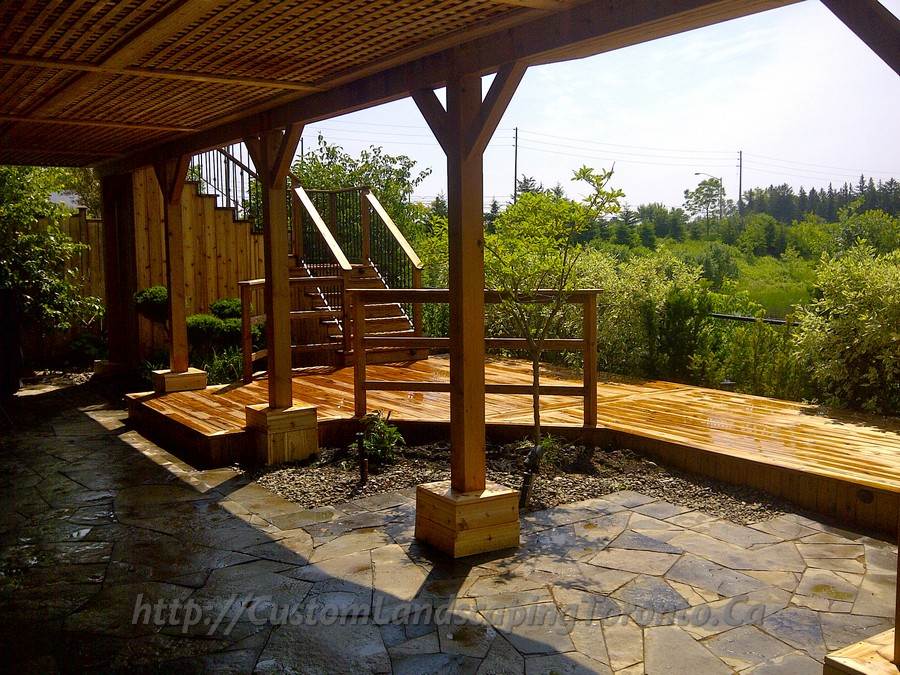 Basement walkout interlock with deck and pergola toronto for Custom landscaping