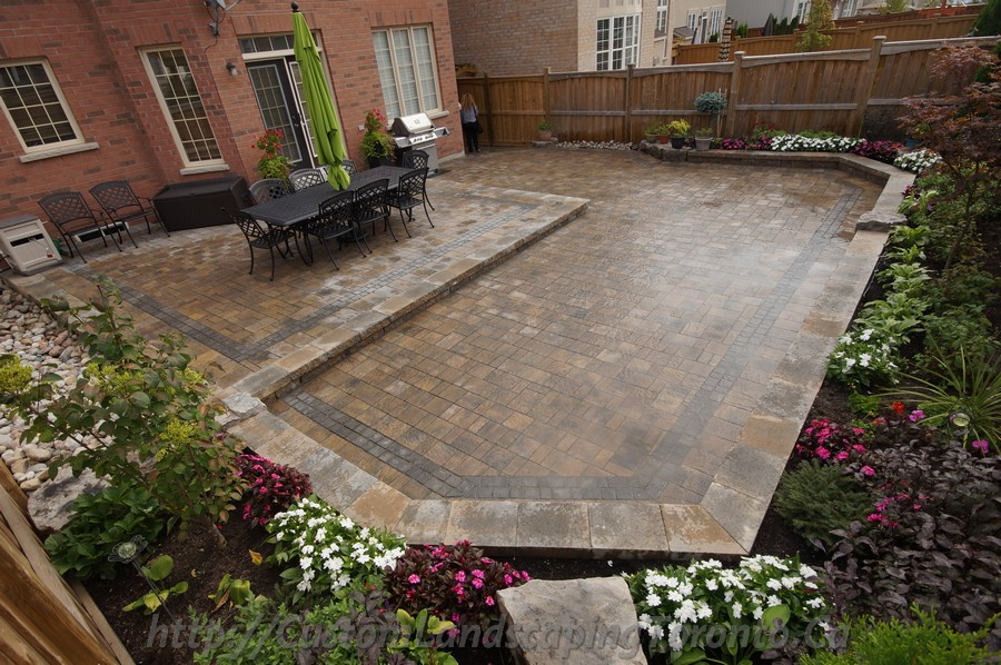 Fire Pit Backyard Toronto : backyard interlocking project with flower beds  Toronto Landscaping