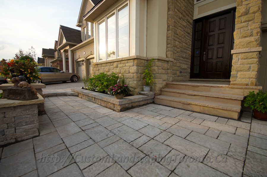 Patio deck with large interlock and landscaping design for Landscape design toronto