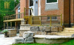 Flagstones and armor stone retaining wall